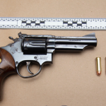 Weapon charges and seized​ handguns