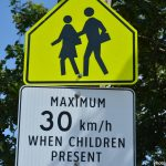 Police ticket a man for careless and imprudent driving near a school