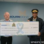 RCMP Sgt. Tony Upshaw received a cheque for $5,000.00 on behalf of the RCMP Foundation and the RCMP Fallen Officer Fund from Ribbon Fundraiser