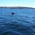 An off-duty RCMP officer and a retired RCMP officer rescued a fisherman from St. Margaret's Bay after the fisherman's boat capsized
